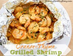 Orange-Thyme Grilled Shrimp is cooked in foil packets right on the grill! The orange and garlic flavors infuse the shrimp with deliciousness, making it moist and flavorful.