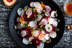 """NYT Cooking: Orange and Radish Salad With Pistachios.  Jay improvised with """"hot"""" (spicy green) radishes & mandarins."""