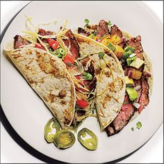 These simple tacos, featuring gorgeous slices of grilled flank steak, have gotten outstanding reviews from fellow MyRecipes users.