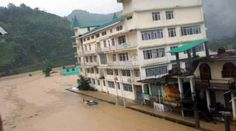 Flooded Dharampur market and bus station after a cloud burst in Mandi district on Saturday. (Source: Express photo)