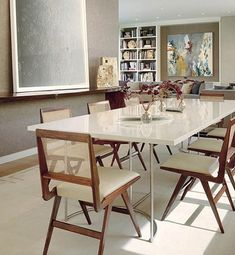 Architect Brooks Walker and interior designer Douglas Durkin renovated a 1951 William Wurster house in San Francisco. The dining area is framed by a floating wall that displays a 2007 photogram by Adam Fuss | archdigest.com
