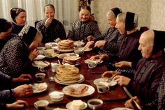 Magnum Photos —Thomas Hoepker — EAST GERMANY. 1975. Women of the Sorbic minority at a pre-Easter dinner in a framer's home near Bautzen.