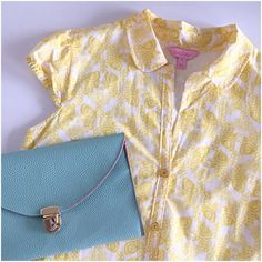 """Lilly Pulitzer fish print cap sleeve blouse Adorable koi print in sunny yellow and white! Enamel yellow buttons, drawstring at bottom hem. You can also tuck this in for a different look. 70% cotton, 30% silk, dry clean. It is lined in 100% cotton so it is not sheer at all. Great condition! Measures 20"""" from underarm to underarm and 27"""" from shoulder to hem. Bundle any two items in my closet for 20% off! Lilly Pulitzer Tops Blouses"""
