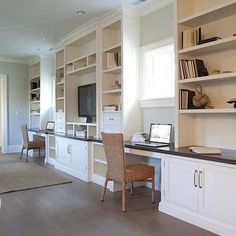 Built-in shelving saves space in a home office. Loving the multiple workspaces in this room.