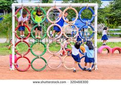 Loei, Thailand - September 24, 2015 : Children playing in the playground, made from recycled car tires, in the country school in Thailand