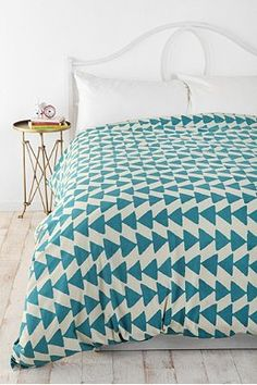 triangle blue duvet cover from urban, perhaps yellow or gray sheets?