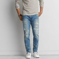 Slim Jean ($50) ❤ liked on Polyvore featuring men's fashion, men's clothing, men's jeans, blue, mens blue ripped jeans, mens distressed jeans, mens low rise jeans, american eagle outfitters mens jeans and mens slim cut jeans