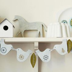 Felt Dove Garland  These pretty felt doves will add subtle holiday cheer to a fireplace mantel or shelf when paired with similarly styled natural decor