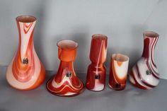 Vintage 70s Murano Carlo Moretti Set.  Left to right.  Large vase: Orange, red, white marbling. Candlestick: Orange, red, white marbling. Vase: Orange, red, white marbling. Vase/candlestick holder: Orange, red, white marbling. Small vase: Purple, grey red