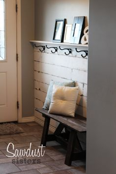 DIY Entry Way Plank Wall. Find the tutorial at http://sawdustsisters.com