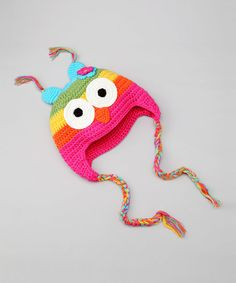 Little darlings will welcome the chilly weather when donning this earflap hat. With such a curious critter perched atop noggins, this charming cap will provide warmth as well as a cuddly companion.