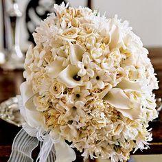 Bouquet of stephanotis, tuberose, hyacinth, nerine lillies, mini callas, garden roses and jasmine