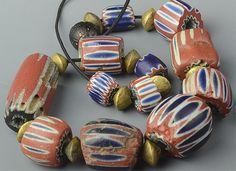 Impressive strand of 19th or early 20th Century graduated Chevron beads. The beads are graduated with the smallest bead measuring 8 in diameter and 12 mm in length; while the largest beads measure a w