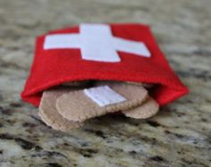 This item is a first aid kit. band-aid tablets medicine bottles cotton balls Each piece is made of felt. It is completely handmade. It can be used as toys for kids, or just as decorative items. This item is already made and ready to ship. Felt Diy, Felt Crafts, Fabric Crafts, Diy For Kids, Crafts For Kids, Diy First Aid Kit, Homemade Stuffed Animals, Felt Play Food, Sewing Projects For Kids