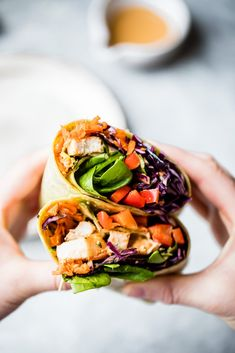Bright, fresh crunchy rainbow Thai peanut chicken wraps packed with veggies like red cabbage, carrot, spinach and red bell pepper. These easy Thai peanut chicken wraps are protein-packed and have a delicious, flavorful peanut dressing for drizzling and dipping. The perfect lunch that's easily made vegetarian or vegan! #lunch #wrap #chicken #mealprep #healthylunch #dairyfree Lunch Recipes, Healthy Recipes, Wrap Recipes, Easy Recipes, Dinner Recipes, Healthy Options, Healthy Foods, Salad Recipes, Easy Meals