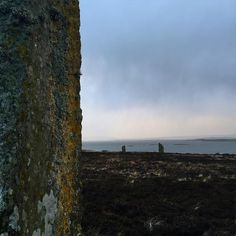 The ancient Ring of Brodgar stands up against howling wind and driving rain in a November storm.  These stones placed during the Neolithic period for a circle standing on the edge of the loch #neolithic  #standingstones #stonecircle #orkney #scotland #nofilter #iphoneonly #onlyiphone #iphone #blogger #travelblogger #remote #wilderness #wild #capturebritain