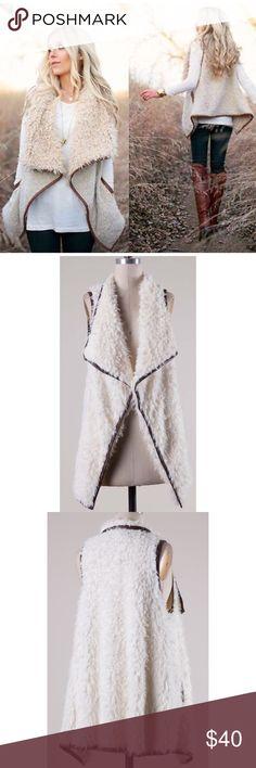 Boho Ivory Shearling Fur Vest S M L Ivory shearling faux fur vest, vegan leather piping, slit pockets, 100% Polyester.  No Trades, Price Firm unless Bundled. BUNDLE 3 OR MORE ITEMS FOR 15 % OFF Boutique Jackets & Coats Vests