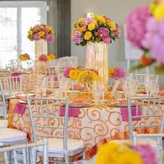 A colorful table settings, with hot pinks and fresh mandarine colors, designed by@brideclubme at the beautiful Jumeirah Golf Estates  Photographer: @enchantestudios Flowers: @blissflowersuae Venue: @jumeirahgolfest Event Organizer: @brideclubme Linens, tablewares & accessories, chair sash: @partysocialuae  #Regram via @partysocialuae