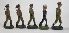 Moulded Elastolin toy soldiers of marching WWII Military Police servicemen…