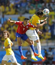 Chile's Alexis Sanchez and Brazil's Thiago Silva go for a header during the World Cup round of 16 soccer match between Brazil and Chile at the Mineirao Stadium in Belo Horizonte, Brazil, Saturday, June 28, 2014.