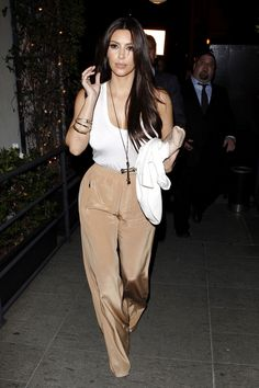 Kim Kardashian outfit is cute simple white tank and beautiful pants