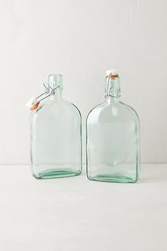 I like it when restaurants leave a bottle of water on your table.  These would be a great addition to the Thanksgiving meal.  This year I am thinking more simply and moving away from the more formal décor of my youth and leaning toward a simple natural setting.  It seems appropriate for a Thanksgiving meal . . . Green Glass Storage Flasks #anthropologie #Anthropologie and #PinToWin