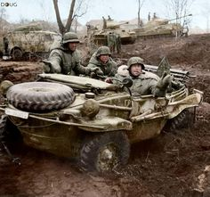 This photo was taken in the Vinnitsa (Vinnytsia) area of the Ukraine in November 1943. The man at the wheel is SS-Hauptsturmführer Gustav Knittel, the commander of the 1st SS Aufklärungs-Abteilung LSSAH at the time. The number plate is 302098, and the vehicle is one of the original Porsche Vorserien Schwimmwagens (literally Floating/Swimming Car) assigned to the LAH in the middle of 1942.