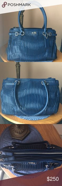 """❌SOLD❌ Coach Madison Gathered Leather Kara Satchel Authentic preowned Coach Madison Gathered Leather Kara Carryall in Bright Marine with Silver Hardware. Style #22325. Dimensions: 13.75"""" L x 11"""" H x 4.25"""" W. Features gathered, pleated Italian leather; belt & buckle detail; Coach hangtag; 2 full zip-top compartments; 2 middle snap compartments; inside zip, cell phone & multifunction pockets; and rolled handles with 7.75"""" drop. Roomy, versatile, retired bag from 2012; only carried a couple of…"""
