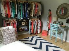 Use a small spare room to make a huge walk in closet and getting ready station - LOVE. Doing this!
