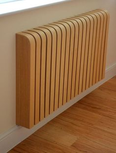 The more unsightly radiators can be covered with a neat moulded wood cover.