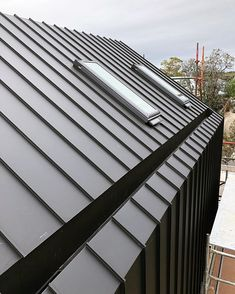 MATERIALS: Standing seam metal roof with concealed gutter