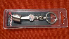Piston keychain with packing