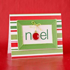 """Create a frame by attaching prestitched ribbon to folded card stock. A charm suspended from string takes the place of the """"o"""" in Noel."""