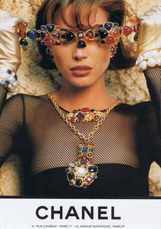 Christy Turlington poses with Chanel costume jewelry, 1990's.