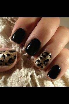 Black polish with a leopard print pattern