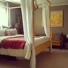 Master bedroom - yellow canopy bed Ikea