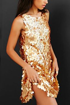 Go for the gold in this modern sequin dress.