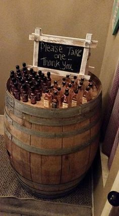 One of wine barrels set up to hold the party favors at this BabyQ Co-ed baby shower.