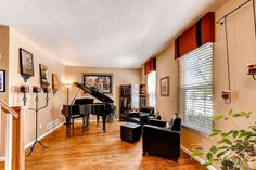 Formal living room with grand piano.