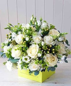 This floral arrangement shows proportion because the amount of white flowers is nearly equal to the amount of greenery.