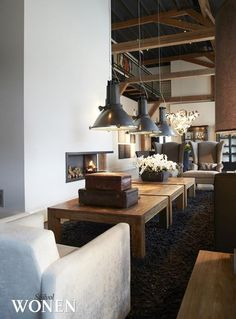 Those industrial lights are cool, but way too low. I know that's the point, but you can't put a tv or anything in from of those couches since they will be in the way of your eye line.