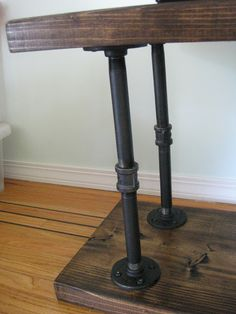 DIY Industrial TV Console- maybe a way to balance th coffee table. The color works well