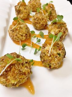 Goat Cheese Fritters: served with a peach honey jam and toasted pistachios