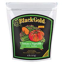 Black Gold Tomato & Vegetable Fertilizer-  One application, non-burning formula. Your edible garden will thrive with this granular 4-5-3 blend of natural nutrients that includes both quick and slow release components. Safe to use on even the most tender plants. 4 pound bag.
