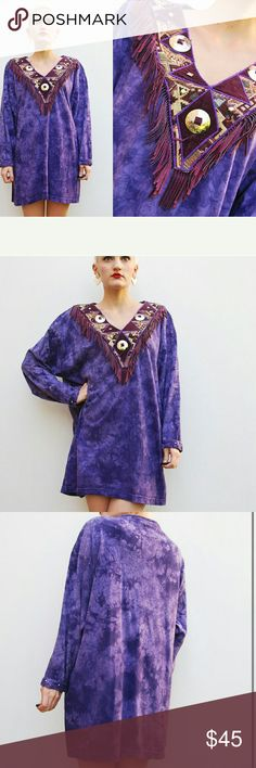 """Sale 80's Purple Tie Dye Tunic with Fringe Neck Vintage item from the 1980s Materials: fringe, velvet, jersey knit, concho, studs Previously Worn 80's purple tie dye jersey knit tunic top. V neckline with tapestry and velvet detailing. Purple leather fringe. Silver conchos and studs. Long sleeves with studded cuffs.   C O N D I T I O N In excellent condition.  M E A S U R E M E N T S  loose // oversized fit!  bust 48""""  total length from shoulder to hem's edge 31 1/2""""  shoulder seam to…"""