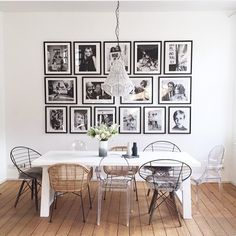 Love the black and white feature wall of art/photography. Would also look great in a lounge room