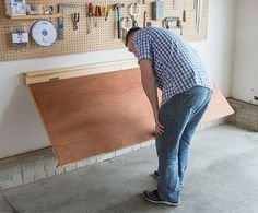 How To Build A Wall-Mounted Folding Workbench – Your Projects Workbench Stool, Workbench Plans Diy, Building A Workbench, Folding Workbench, Garage Workbench, Industrial Workbench, Workbench Designs, Fold Down Work Bench, Fold Down Table