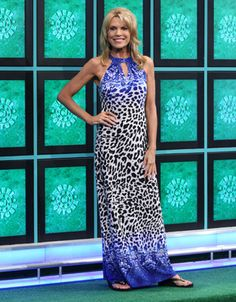 CACHE: Long jersey dress w/halter neckline and upper bodice in blue, white & black abstract paisley print, lower bodice to knee level in black & white abstract dot pattern, hemline in same print as up | Vanna White's dresses | Wheel of Fortune