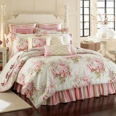 i think i need to buy everything in this picture! except the ugly frill on the bottom and the striped pillows...