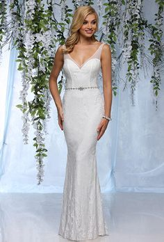 Destiny. Elegant embroidered lace appliqu�s on all over tulle. Charmeuse underlay sheath gown with a V-neckline, illusion straps that flow into a stunning V-back and beautiful jeweled band at waist.